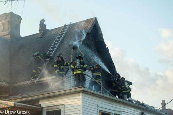 firefighters chase hot spots after house fire