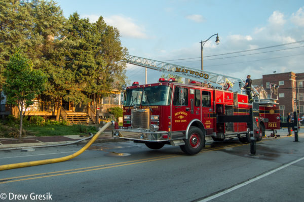 Maywood Fire Department ladder truck at fire scene