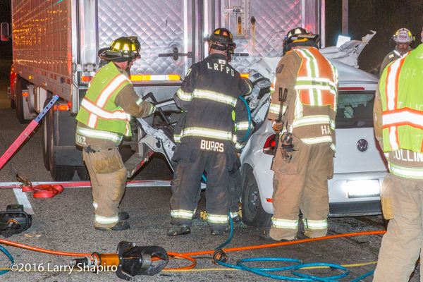 firefighters free trapped driver  from car wreck