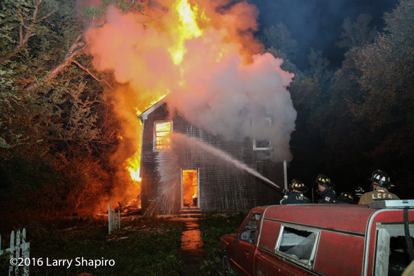 vacant house engulfed in fire