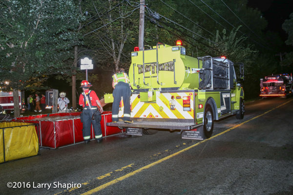 Elk Grove Township FD tender dumps water at fire scene