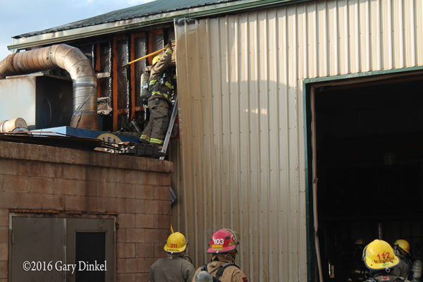 firefighters overhaul after fire