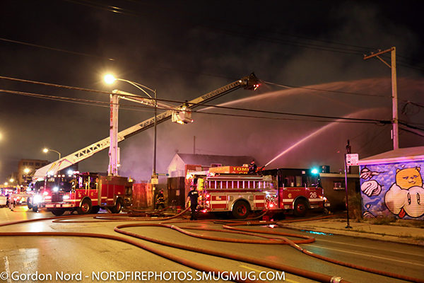 fire scene at night with fire trucks