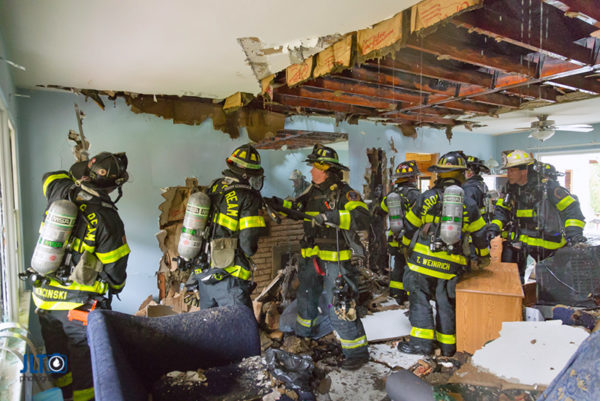 firefighters overhaul house after fire