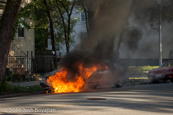 car fully engulfed in fire