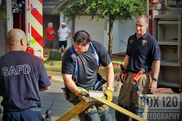firefighters drain hose after fire