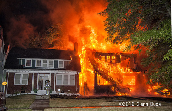 vacant house fully engulfed in flames at night spreads to other house