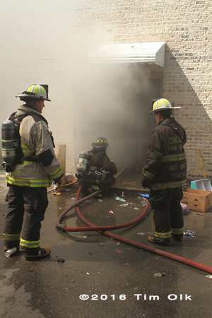 fire chief supervises firefighters at scene