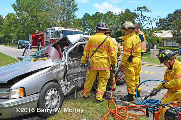 firefighters free driver trapped in car