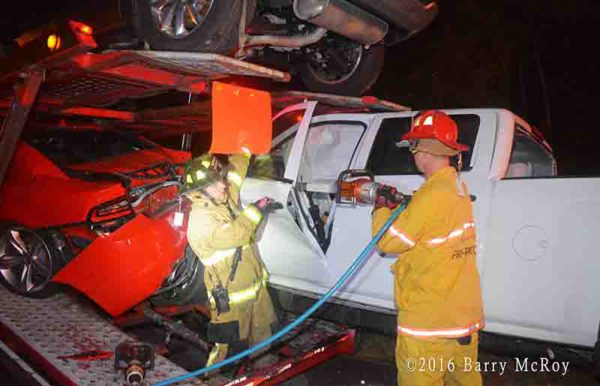 firefighters use Holmatro tools to cut driver from car