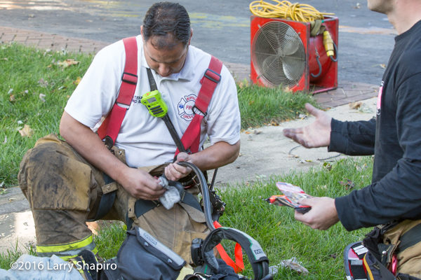 firefighter decontaminates PPE