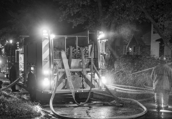 fire engine at night with hose off