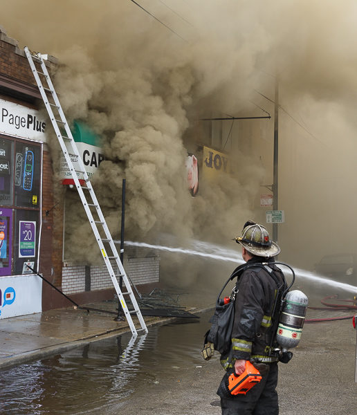 firefighters battle commercial fire