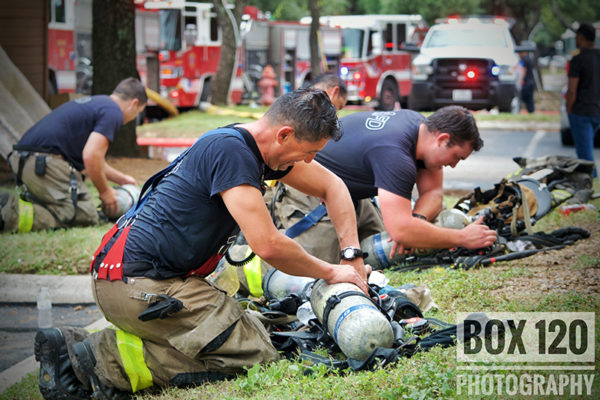 firefighters changing SCBA bottles