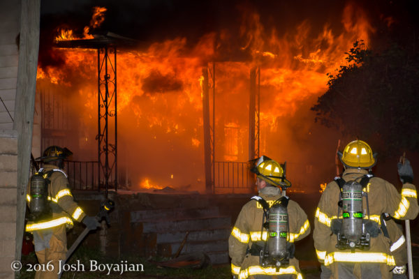 Detroit firefighters at the scene of a vacant dwelling fire