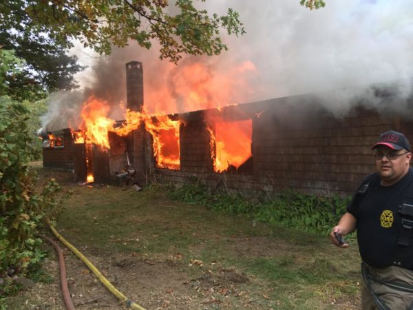 fire department burning a house down