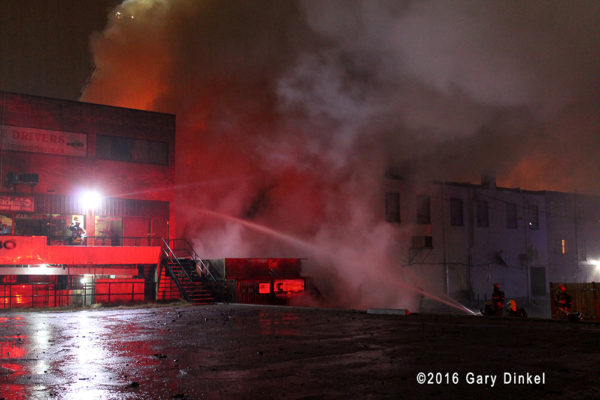 Kitchener firefighters battle a fire at night