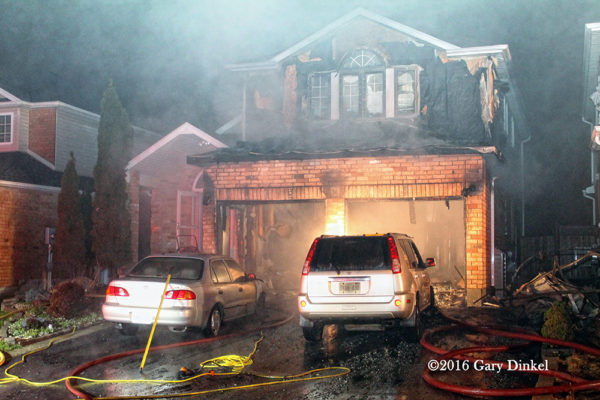 aftermath of garage fire attached to a house