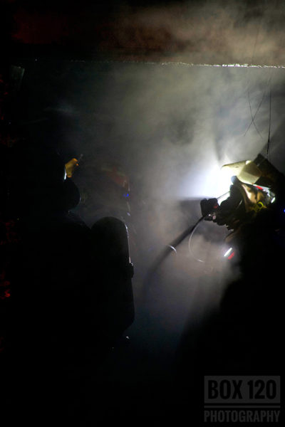 Firefighter silhouette at fire scene