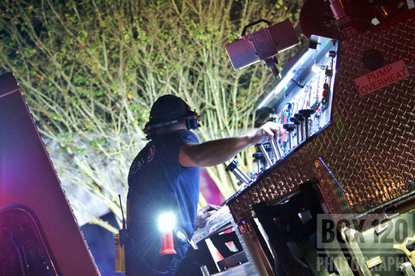 San Antonio Firefighter at pump panel