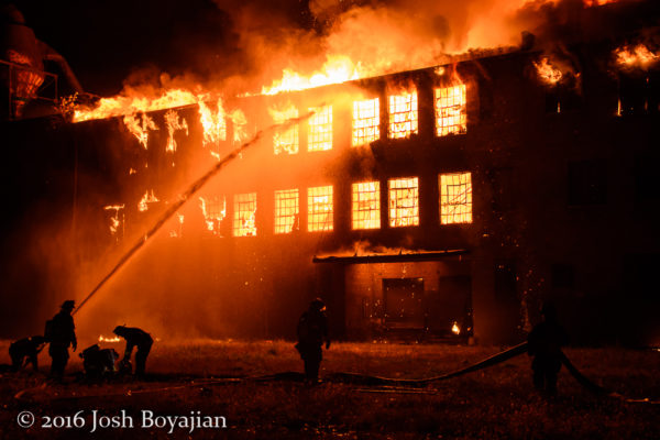 masive warehouse fire at night
