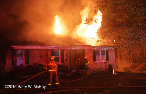 firefighters battle ranch house on fire with flames
