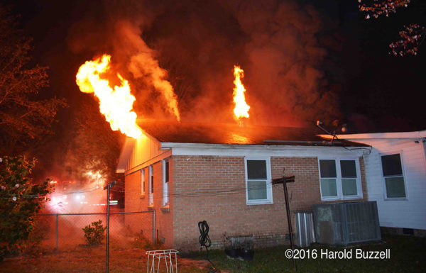 ranch house on fire with flames