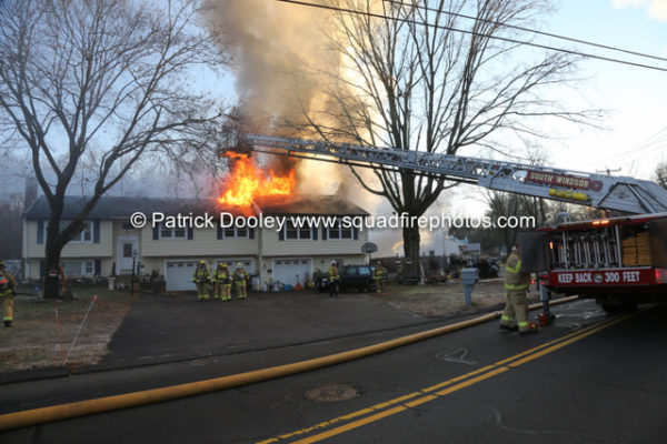 heavy smoke and flames from house fire in South Windsor CT