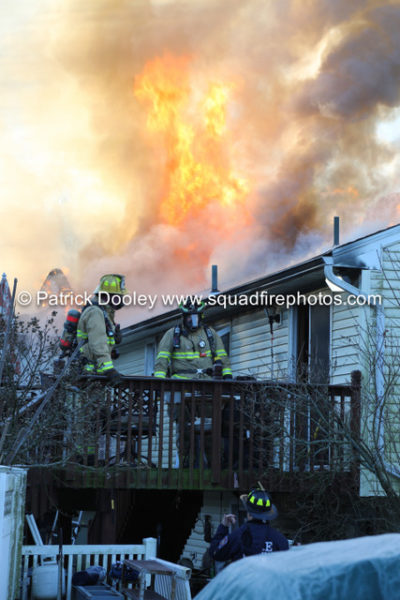 firefighters battle heavy smoke and flames from house fire in South Windsor CT