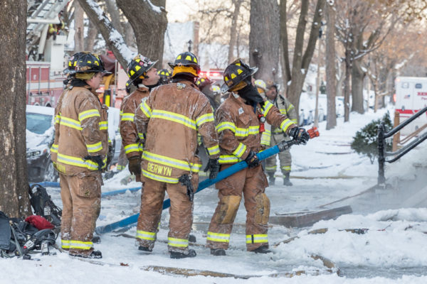 firefighters in freezing cold at fire scene