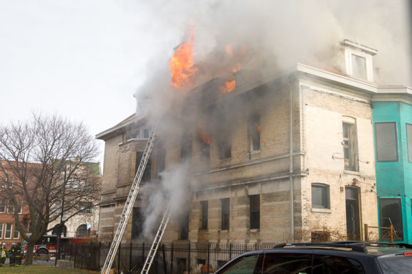 flames out the windows of a house