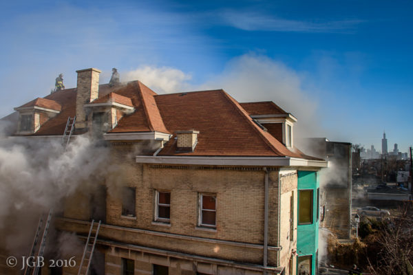 firefighters vent roof of house fire