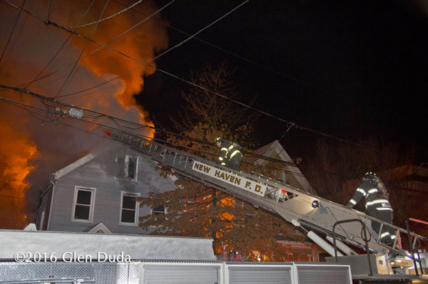 New Haven firefighters battle a house fire