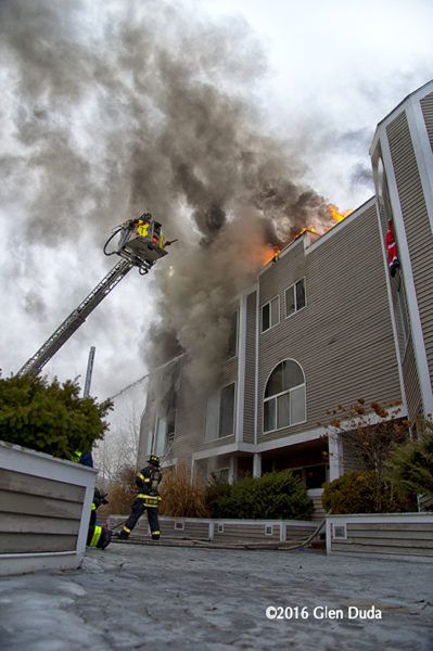 firefighters battle fire in a condo building