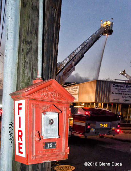 old fashioned fire alarm box near warehouse fire