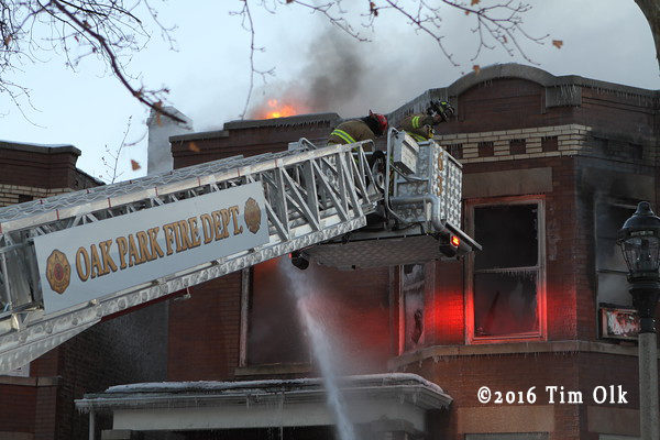 Oak Park FD tower ladder working at a house fire