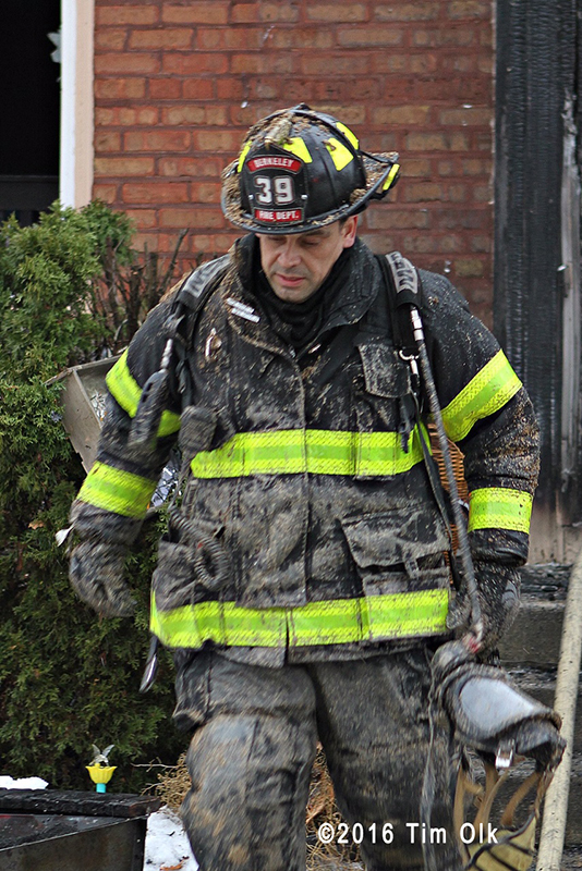 firefighter after battling a house fire