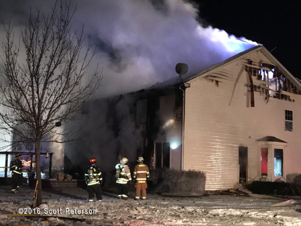 house fire scene at night