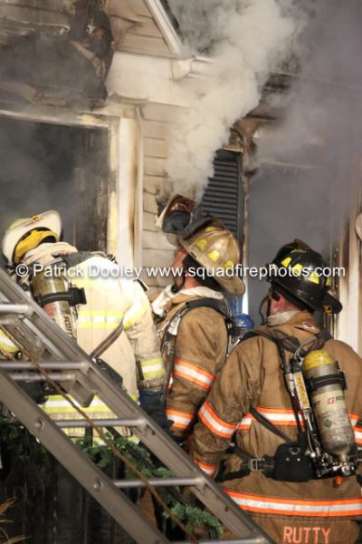 firefighters working at a house fire