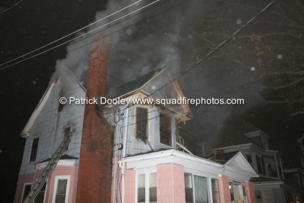 smoke from attic at house fire at night