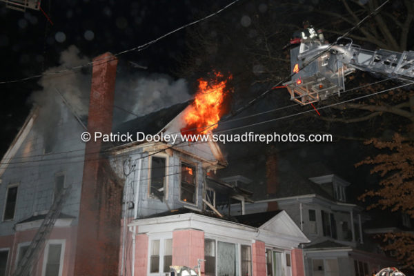 smoke and flames from house attic at night