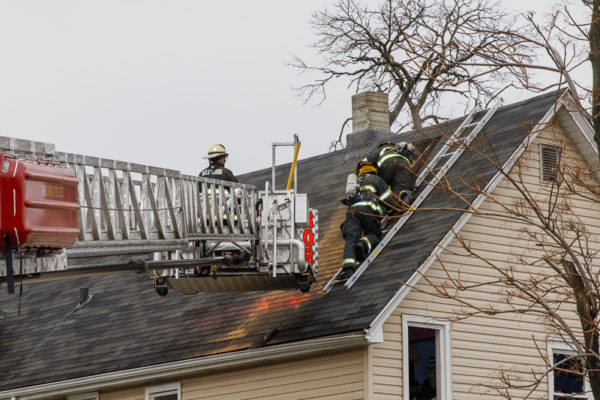 firefighters vent roof after house fire
