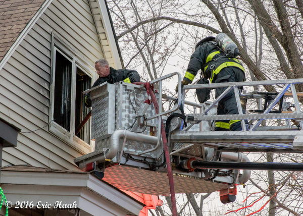 firefighters work from tower ladder