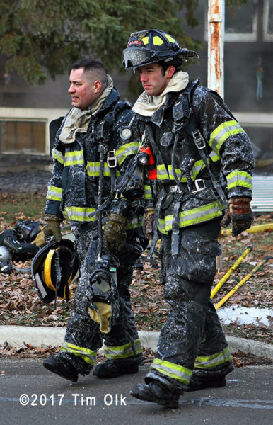 firefighters after battling fire on a cold day