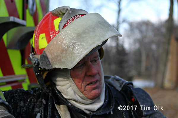 firefighter with helmet coated with ice