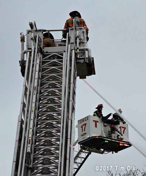 2 tower ladders with elevated master streams