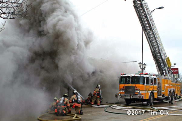 firefighters battle smokey fire in store