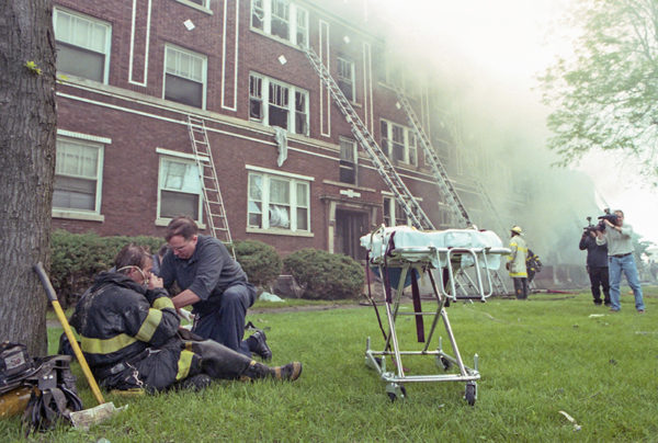 firefighter getting oxygen at fire scene