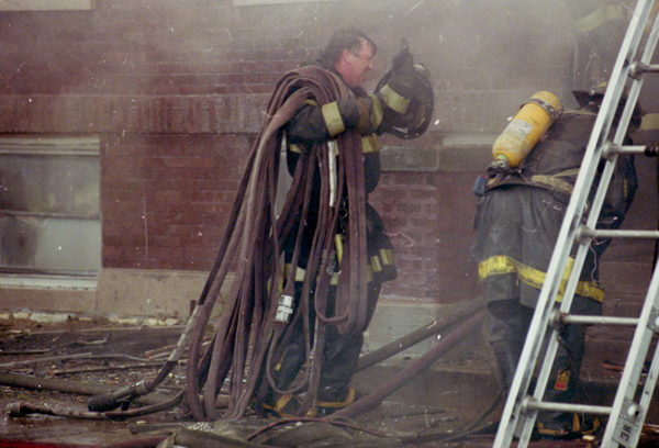 vintage Chicago firefighter at fire scene