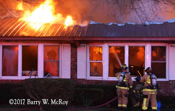firefighters battle house fire with heavy flames